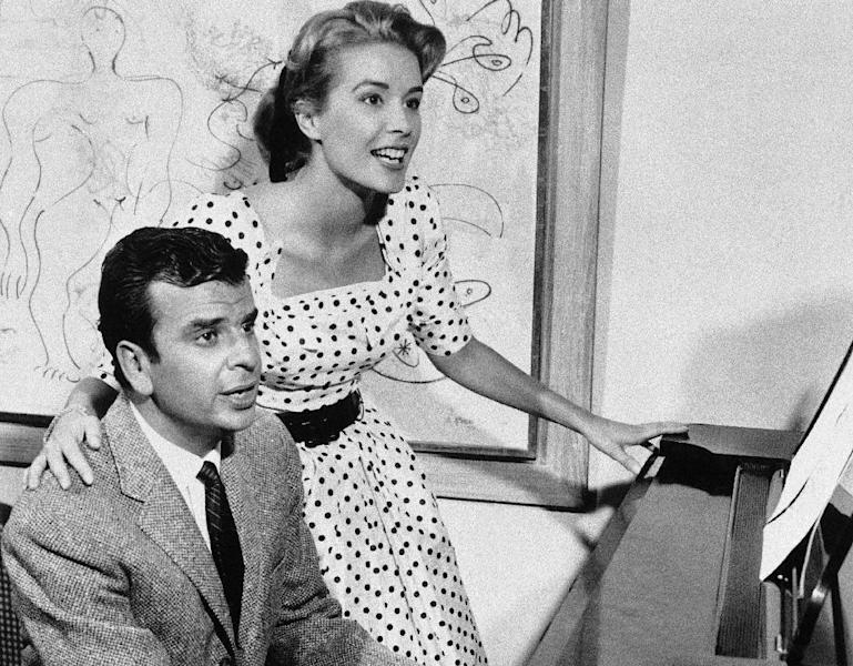 """This Sept. 8, 1961 file photo shows Broadway composer Richard Adler, left, and his wife actress-singer Sally Ann Howes in New York. Adler, who won Tony Awards for co-writing the songs for such hit musicals as """"The Pajama Game"""" and """"Damn Yankees,"""" died Thursday, June 21, 2012 at his home in Southampton, N.Y., according to his family. He was 90. Some of Adler's biggest songs are """"You Gotta Have Heart,"""" """"Hey, There,"""" """"Hernando's Hideaway,"""" """"Whatever Lola Wants,"""" """"Steam Heat,"""" """"Rags to Riches,"""" and """"Everybody Loves a Lover."""" (AP Photo, file)"""