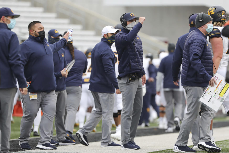 California head coach Justin Wilcox, center, signals to players during the first half of an NCAA college football game against Oregon State in Corvallis, Ore., Saturday, Nov. 21, 2020. (AP Photo/Amanda Loman)