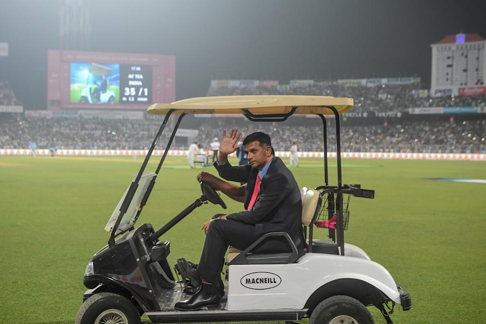 Former Indian cricket captain Rahul Dravid rides in a golf cart during a break on the first day of the second Test cricket match of a two-match series between India and Bangladesh at The Eden Gardens cricket stadium in Kolkata on November 22, 2019. (Photo by Dibyangshu SARKAR / AFP) / IMAGE RESTRICTED TO EDITORIAL USE - STRICTLY NO COMMERCIAL USE