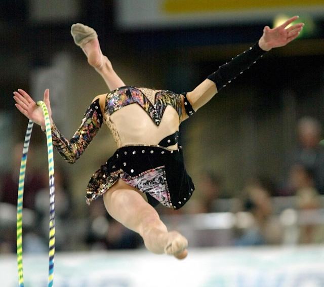 Elizabeth Paysieva from Bulgaria performs with the hoop during the Rhythmic Gymnastics World Cup Final in the Hanns-Martin-Schleyer Hall in Stuttgart, southwestern Germany, Sunday, Dec.1, 2002. She took the 8th place, the rope and hoop world cup was won by Ukrainian Anna Bessonova. (AP Photo/Thomas Kienzle)