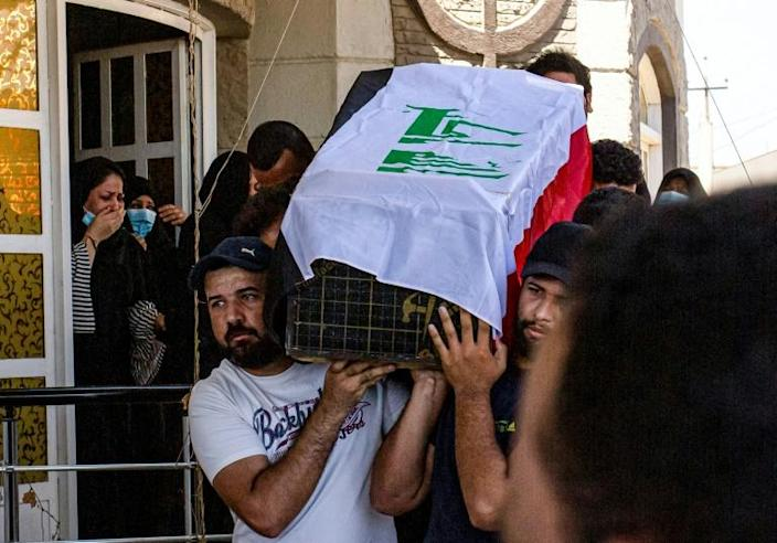 Mourners carry Yaaqub's coffin during her funeral on Thursday