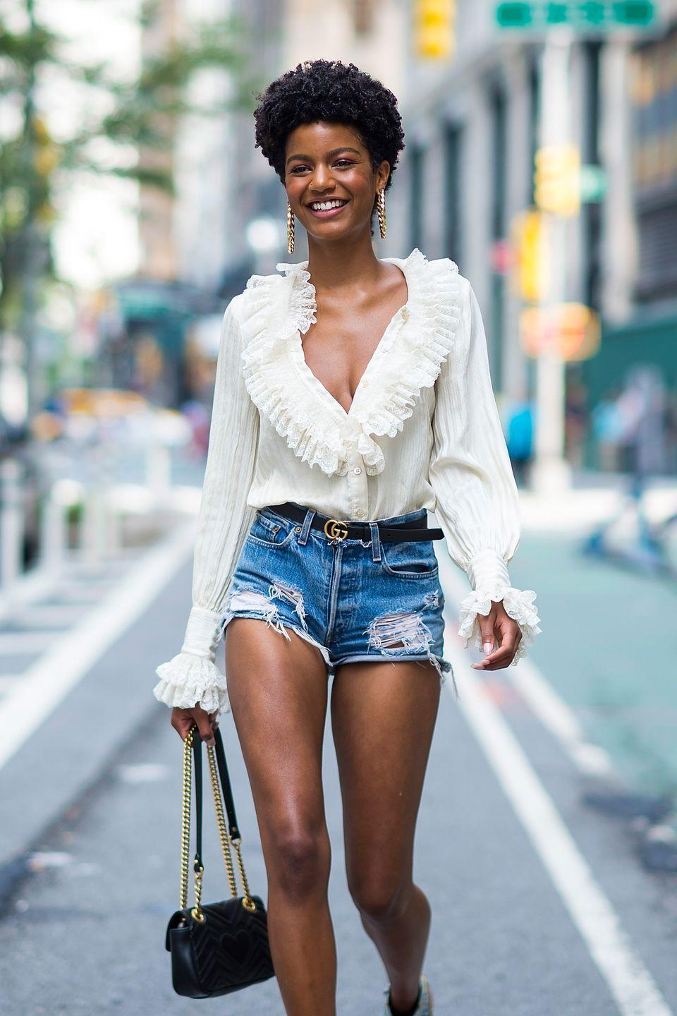 <p>Model <strong>Ebonee Davis</strong> is all smiles with hair styled in finger coils. Smart tip: The smaller the coils, the longer they last. </p>