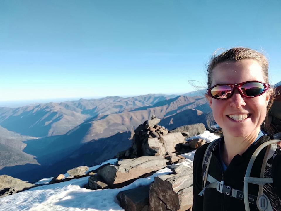 Esther Dingley smiles at the top of Pic de Sauvegarde in the Pyrenees.
