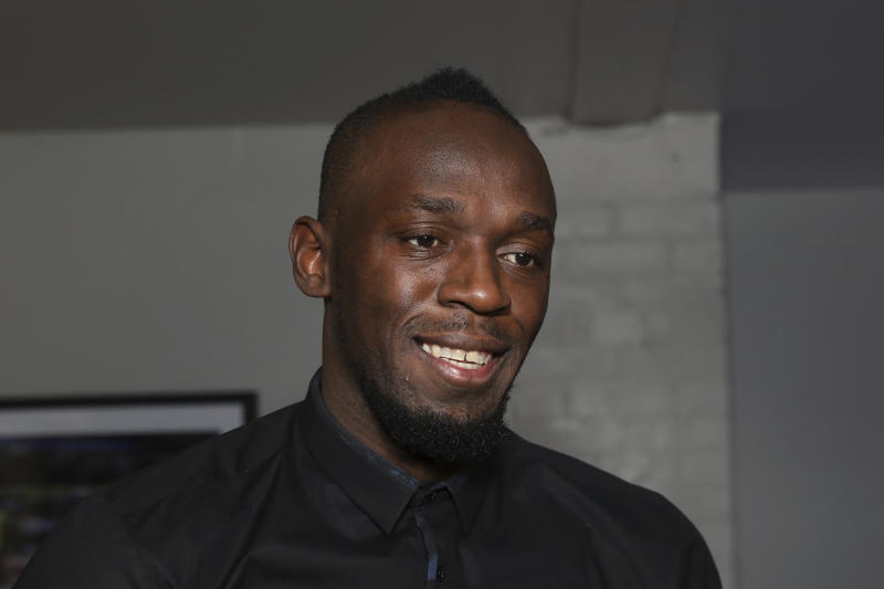 Usain Bolt wants to play with Tom Brady or Aaron Rodgers. (Photo by Grant Pollard/Invision/AP)