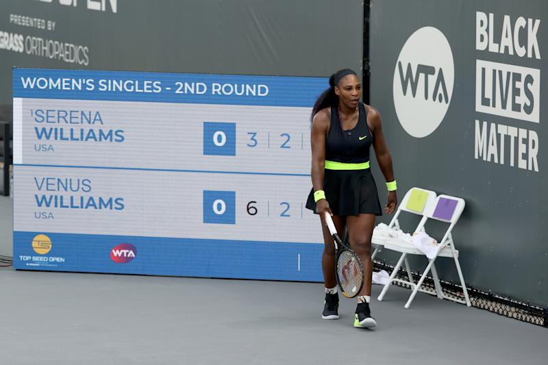 Serena Williams walks across the court during her match against Venus Williams during Top Seed Open.