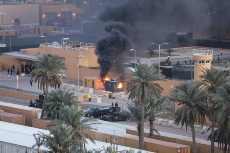 A sentry box burns at an entrance to the United States embassy in the Iraqi capital Baghdad