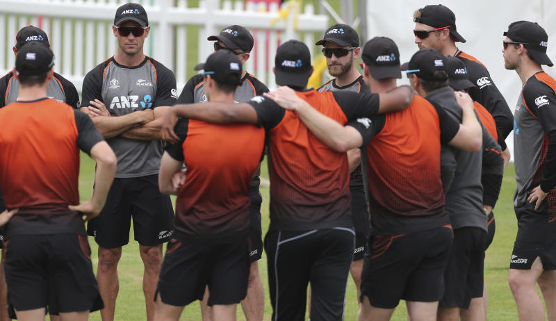 New Zealand's captain Kane Williamson, center right facing camera, stands with teammates during a training session ahead of the Cricket World Cup final match against England at Lord's cricket ground in London, England, Saturday, July 13, 2019. (AP Photo/Aijaz Rahi)