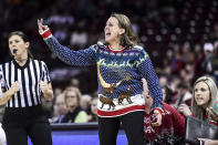 South Dakota coach Dawn Plitzuweit, center, communicates with players during the first half of an NCAA college basketball game against South Carolina, Sunday, Dec. 22, 2019, in Columbia, S.C. (AP Photo/Sean Rayford)