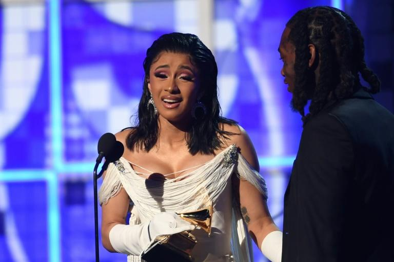 Cardi B was visibly shaking as she accepted the Grammy for Best Rap Album, clutching onto her husband the rapper Offset