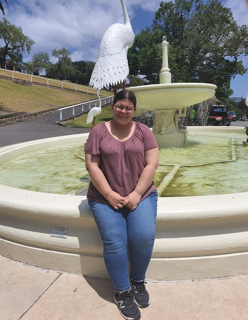 Crystal is seen standing in front of a fountain. Source: Supplied