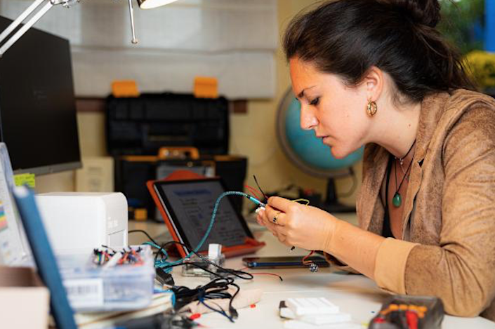 Judit Giró Benet works on the prototype for her breast-cancer detecting Blue Box.