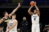 Penn State's Myles Dread shoots a 3-pointer over Purdue's Mason Gillis during an NCAA college basketball game Friday, Feb. 26, 2021, in State College, Pa. (Abby Drey/Centre Daily Times via AP)