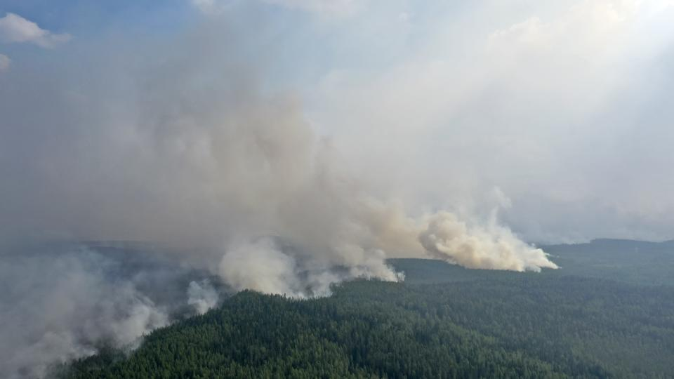 Smoke rises from a forest fire near the Syamozero Lake in Pryazhinsky District of the Republic of Karelia, about 700 km.(438 miles) south-west of Moscow, Russia on Wednesday, July 21, 2021. Volunteers have helped in Karelia as well. Anna Gorbunova, coordinator with the Society of Volunteer Forest Firefighters that focuses on the Ladoga Skerries national park in Karelia, told The Associated Press last week that the blazes there this year are the biggest since 2008. (AP Photo/Ilya Timin)