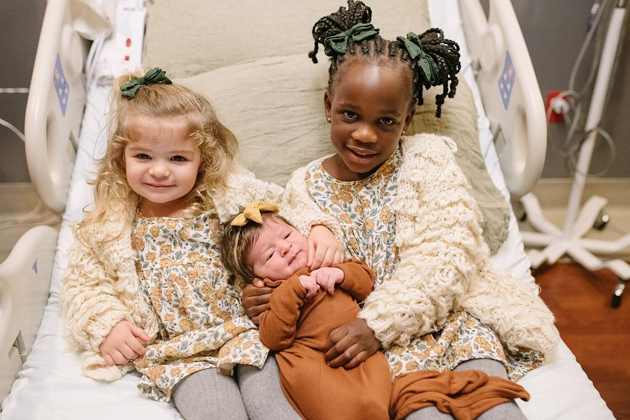 "Lennon's sisters, Willa Gray, 4, and Ada James, 2, are already nailing their big sister duties!   ""Our early Valentine baby was born yesterday, February 10th and her sisters couldn't be happier to finally get to kiss her little face 🥰,"" Akins captioned a photo of her three children."