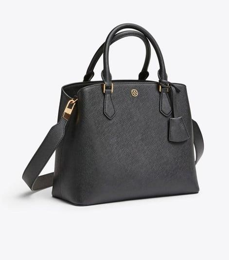 """<p>This classic <a href=""""https://www.popsugar.com/buy/Tory-Burch-Robinson-Triple-Compartment-Tote-487520?p_name=Tory%20Burch%20Robinson%20Triple-Compartment%20Tote&retailer=toryburch.com&pid=487520&price=269&evar1=fab%3Aus&evar9=46235460&evar98=https%3A%2F%2Fwww.popsugar.com%2Ffashion%2Fphoto-gallery%2F46235460%2Fimage%2F46577870%2FTory-Burch-Robinson-Triple-Compartment-Tote&list1=shopping%2Ctory%20burch%2Cbags%2Csale%20shopping&prop13=api&pdata=1"""" rel=""""nofollow"""" data-shoppable-link=""""1"""" target=""""_blank"""" class=""""ga-track"""" data-ga-category=""""Related"""" data-ga-label=""""https://www.toryburch.com/robinson-triple-compartment-tote/56600.html?color=001"""" data-ga-action=""""In-Line Links"""">Tory Burch Robinson Triple-Compartment Tote</a> ($269, originally $458) will never go out of style.</p>"""