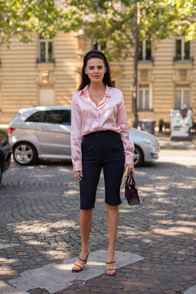 Style Long Shorts With a Silk Blouse, Headband, and Black Heels