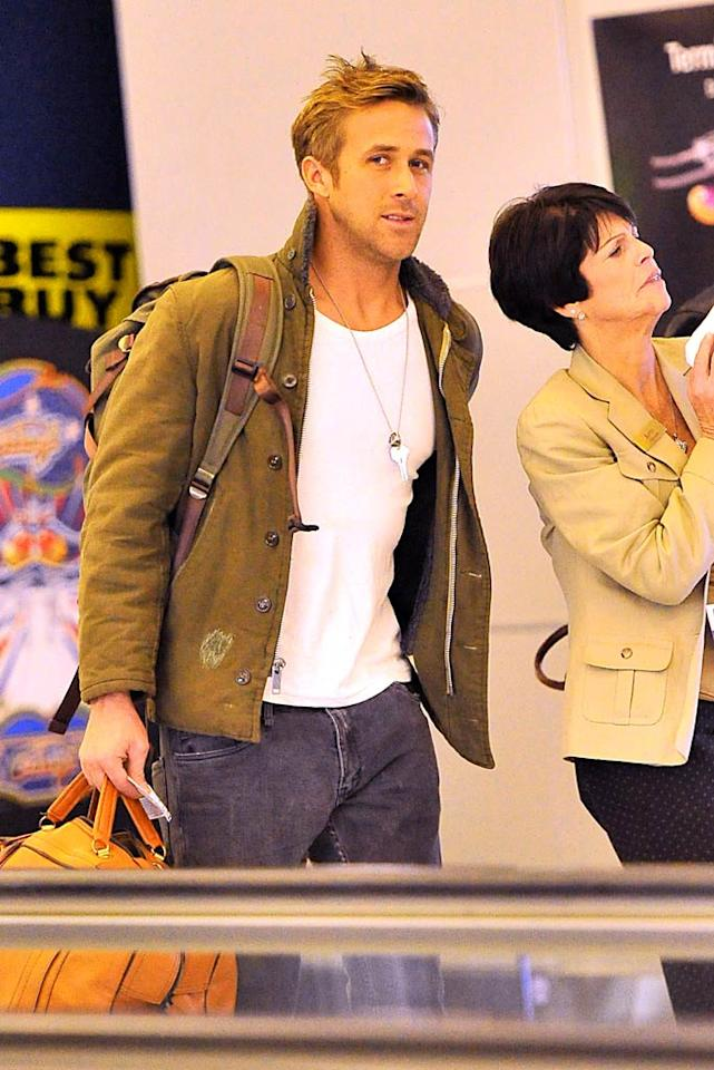 Ryan Gosling and Eva Mendes must be getting serious. The new couple flew to NYC on Friday and spent the New Year together -- even meeting Ryan's mom for a movie Sunday! For some reason, the Hollywood hotties are still reluctant to be photographed together though, and arrived separately at the Big Apple's JFK Airport to fly back to L.A. on Sunday. (01/02/2012)