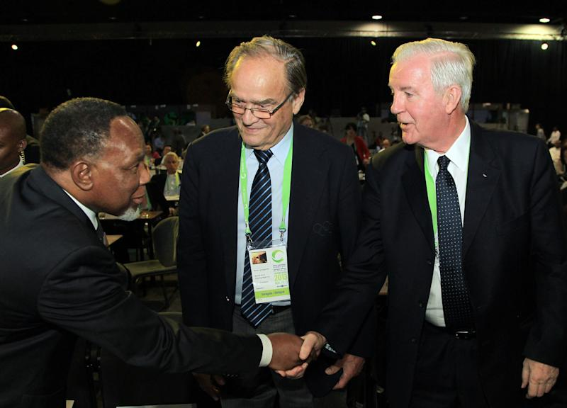 International Olympic Committee (IOC) vice-president Craig Reedie, right, and outgoing World Anti-Doping Agency (WADA) vice-president Arne Ljungqvist, center, meet with South African Deputy President Kgalema Motlanthe, during the World Conference on Doping in Sport, Johannesburg, South Africa, Friday, Nov. 15, 2013. WADA will elect a new leader on Friday and Britain's Craig Reedie is the only candidate to take over as president. He is set to take office on Jan. 1. (AP Photo/Themba Hadebe)