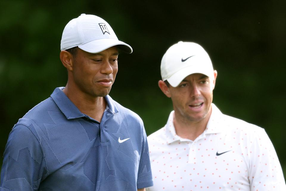 Rory McIlroy (pictued right) and Tiger Woods (pictured left) wait on the first tee during the third round of The Northern Trust at TPC Boston on August 22, 2020 in Norton, Massachusetts.