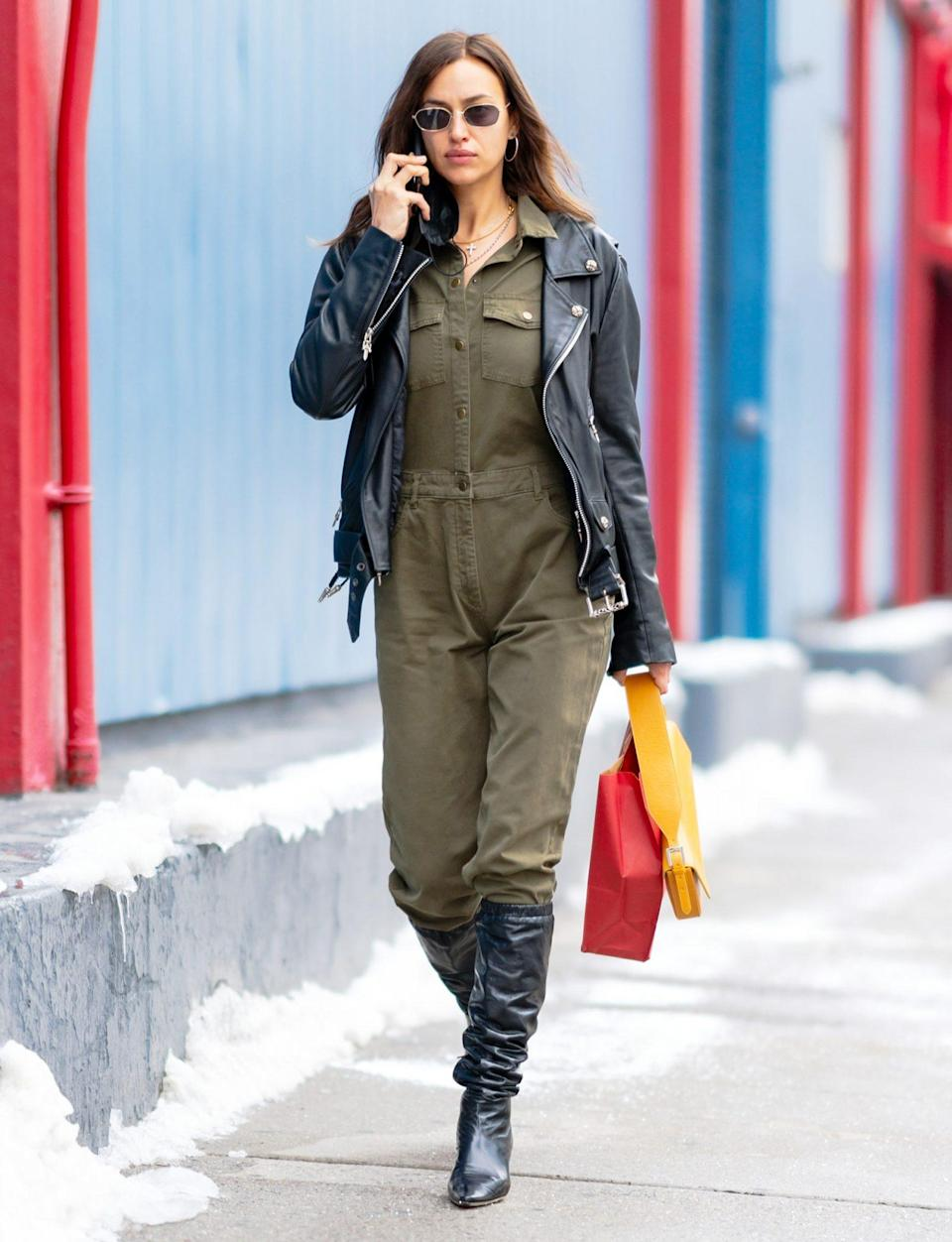 <p>Irina Shayk shows off her street style in an olive green jumpsuit on Sunday in N.Y.C. </p>