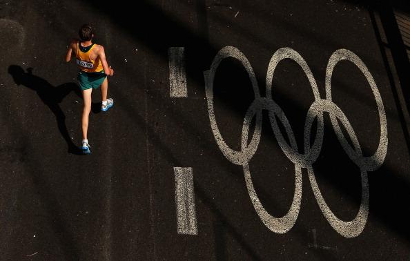LONDON, ENGLAND - AUGUST 12:  Michael Shelley of Australia competes in the Men's Marathon on Day 16 of the London 2012 Olympic Games on the streets of London on August 12, 2012 in London, England.  (Photo by Ezra Shaw/Getty Images)