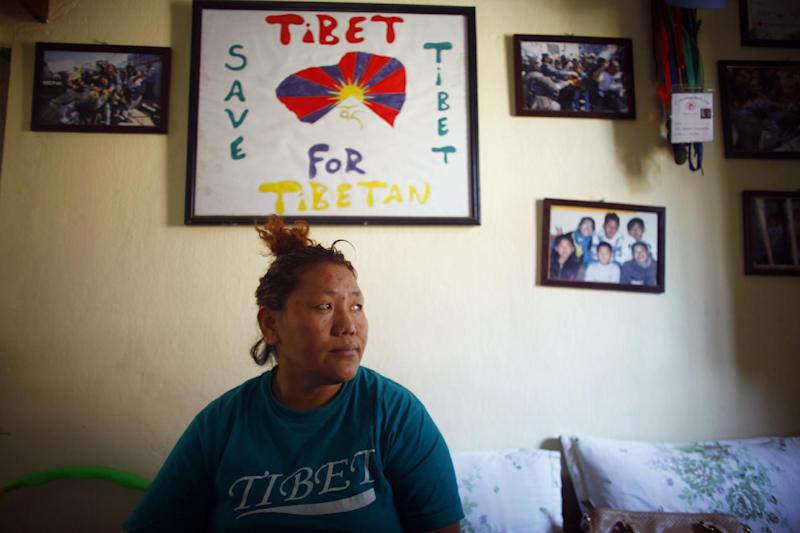 In this Wednesday, April 2, 2014 photo, Sonam Chodon sits in her home inside the Tibetan refugee camp in Katmandu, Nepal. Chodon said she and another Tibetan Sonam Tashi were held for weeks after being picked up by police who broke up a small rally in front of the Chinese Embassy visa office on March 10 and were released only this week without charges or access to legal aid in a sign that authorities are bowing to pressure from China. The government on Thursday denied accusations in a report by Human Rights Watch that it is mistreating Tibetans. Nearly 20,000 Tibetans who fled their homeland now live in Nepal. (AP Photo/Niranjan Shrestha)