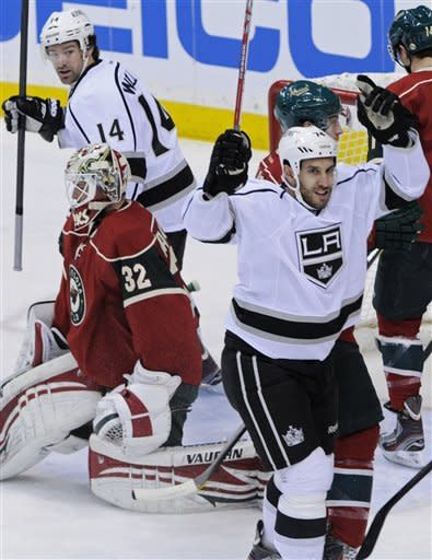 Los Angeles Kings' Dwight King, right, celebrates his goal against Minnesota Wild goalie Niklas Backstrom of Finland, left, in the first period of an NHL hockey game Tuesday, Feb. 28, 2012 in St. Paul, Minn. Background left, is Kings' Jordan Nolan. (AP Photo/Jim Mone)
