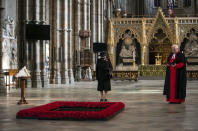 Britain's Queen Elizabeth II, listens as the Dean Of Westminster Abbey David Hoyle reads, during a ceremony to mark the centenary of the burial of the Unknown Warrior, in Westminster Abbey, London, Wednesday, Nov. 4, 2020. Queen Elizabeth II donned a face mask in public for the first time during the coronavirus pandemic when attending a brief ceremony at Westminster Abbey last week to mark the centenary of the burial of the Unknown Warrior. While the 94-year-old has been seen in public on several occasions over the past few months, she has not worn a face covering. (Aaron Chown/Pool Photo via AP)