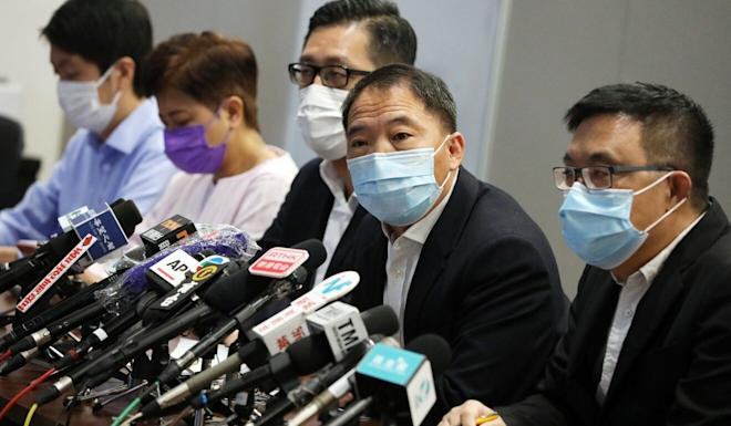 The Democratic Party holds a press conference on letting Hongkongers decide the fate of its seven legislators through a survey. Photo: May Tse
