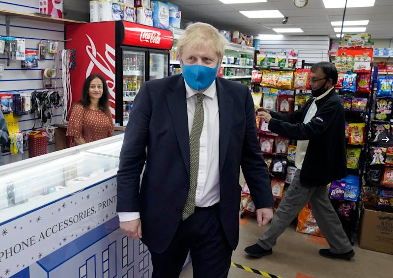 "<strong>The PM in face mask as he visited businesses in Uxbridge on Friday and urged people to ""be sure to follow the guidelines on social distancing"".</strong> (Photo: Downing Street)"