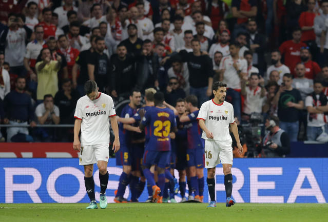 Barcelona's Lionel Messi celebrates with teammates after scoring his side's second goal during the Copa del Rey final soccer match between Barcelona and Sevilla at the Wanda Metropolitano stadium in Madrid, Spain, Saturday, April 21, 2018. (AP Photo/Paul White)