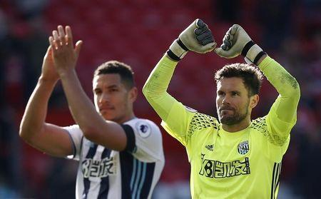 Britain Soccer Football - Manchester United v West Bromwich Albion - Premier League - Old Trafford - 1/4/17 West Bromwich Albion's Ben Foster and Jake Livermore celebrate after the match Reuters / Andrew Yates Livepic