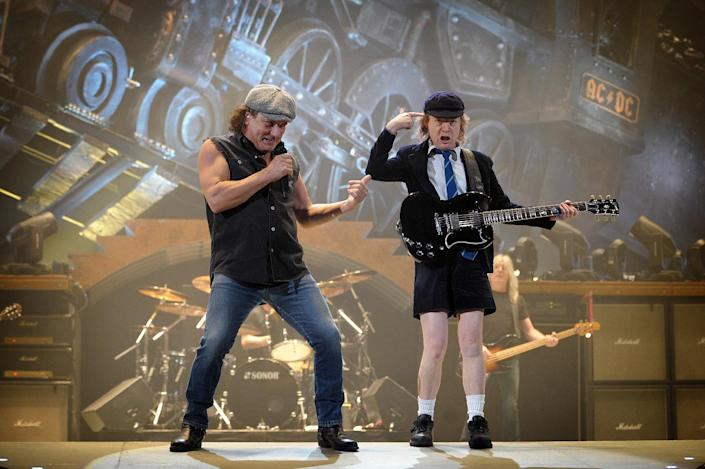 Singer Brian Johnson (L) and guitarist Angus Young of the hard rock band AC/DC perform on February 25, 2009, in Paris (AFP Photo/Olivier Laban-Mattei)