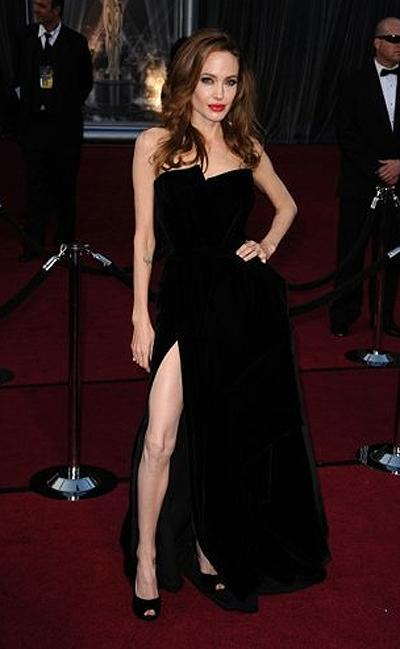<p><b>Angelina Jolie</b></p> <p>After a slew of relatively modest red carpet appearances in promotion of her directorial debut, <em>In the Land of Blood and Honey</em>, Angelina Jolie showed us a hint-make that a leg-ful-of her erstwhile provocative self at the Oscars in an alluring black velvet Versace dress. Her right leg went viral overnight.</p>