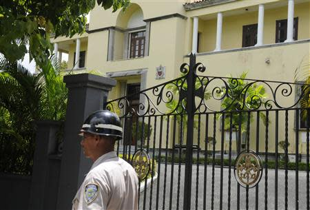 A police officer walks past the Apostolic Nunciature, where the Vatican's ambassador to the Dominican Republic Archbishop Josef Wesolowski resided, in Santo Domingo September 4, 2013. REUTERS/Ricardo Rojas