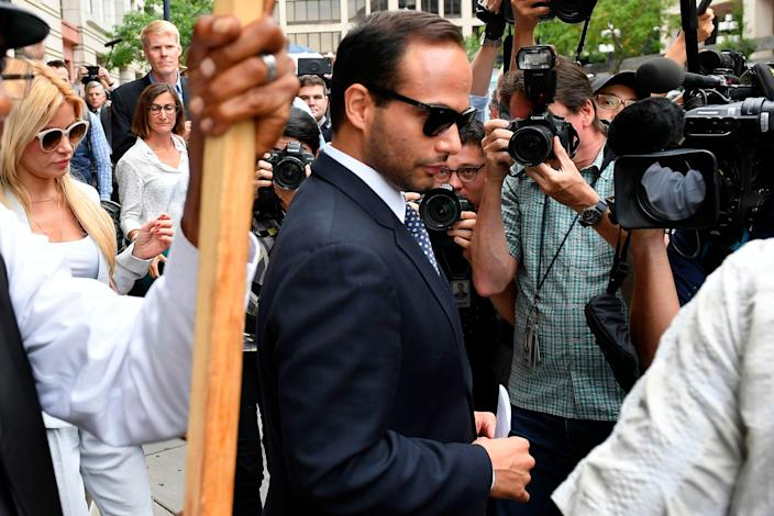 Foreign policy advisor to President Donald Trump's election campaign, George Papadopoulos and his wife Simona Mangiante Papadopoulos leave a federal court in Washington after his sentencing on September 7, 2018.