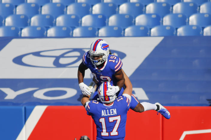 Buffalo Bills quarterback Josh Allen (17) celebrates with teammate Isaiah McKenzie after they connected for a touchdown during the first half of an NFL football game against the Seattle Seahawks Sunday, Nov. 8, 2020, in Orchard Park, N.Y. (AP Photo/Jeffrey T. Barnes)