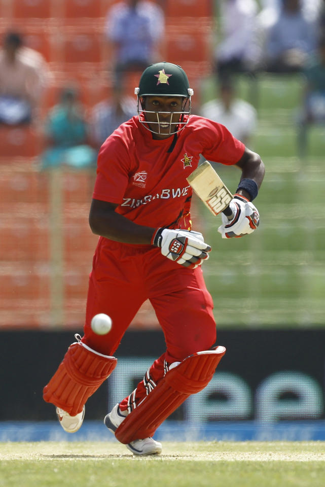 Zimbabwe's Elton Chigumbura runs after playing a shot during their ICC Twenty20 Cricket World Cup match against United Arab Emirates, in Sylhet, Bangladesh, Friday, March 21, 2014. (AP Photo/A.M. Ahad)