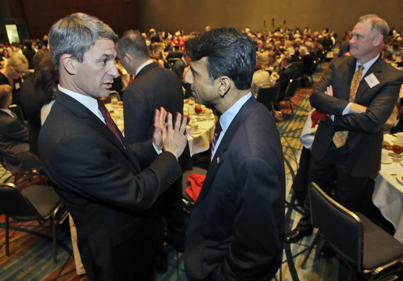 Virginia Attorney General, Ken Cuccinelli, talks with Louisiana Gov. Bobby Jindal,  right, during a dinner as part of the Virginia Republican convention in Richmond, Va., Friday, May 17, 2013.   (AP Photo/Steve Helber)