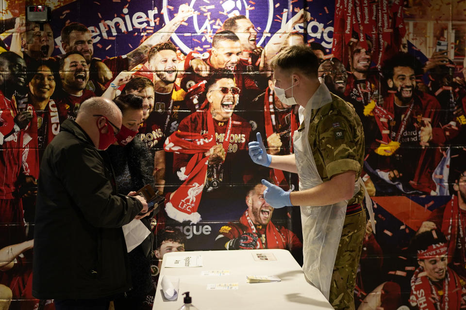 LIVERPOOL, ENGLAND - NOVEMBER 11: Gunners from the Royal Artillery operate a coronavirus disease (Covid-19) testing centre at Liverpool Football Club's Anfield stadium on November 11, 2020 in Liverpool, England. More than 23,000 people had been tested for covid-19 in the first three days of the city's mass testing trial. In that time, 154 people tested positive. All residents and workers in the city were offered the test. (Photo by Christopher Furlong/Getty Images)