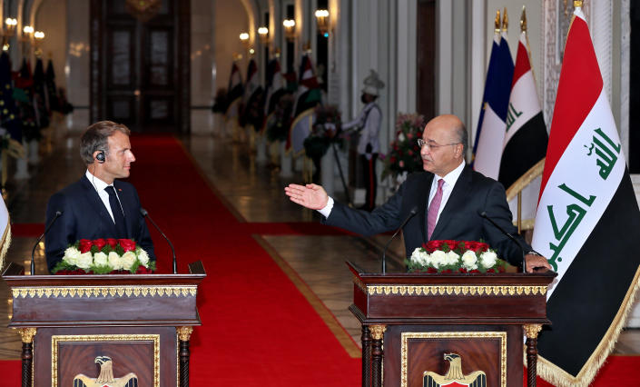 Iraqi President Barham Salih, right, and French President Emmanuel Macron attend a press conference, in Baghdad's Presidential Palace, Saturday, Aug. 28, 2021. (AP Photo/Khalid Mohammed)