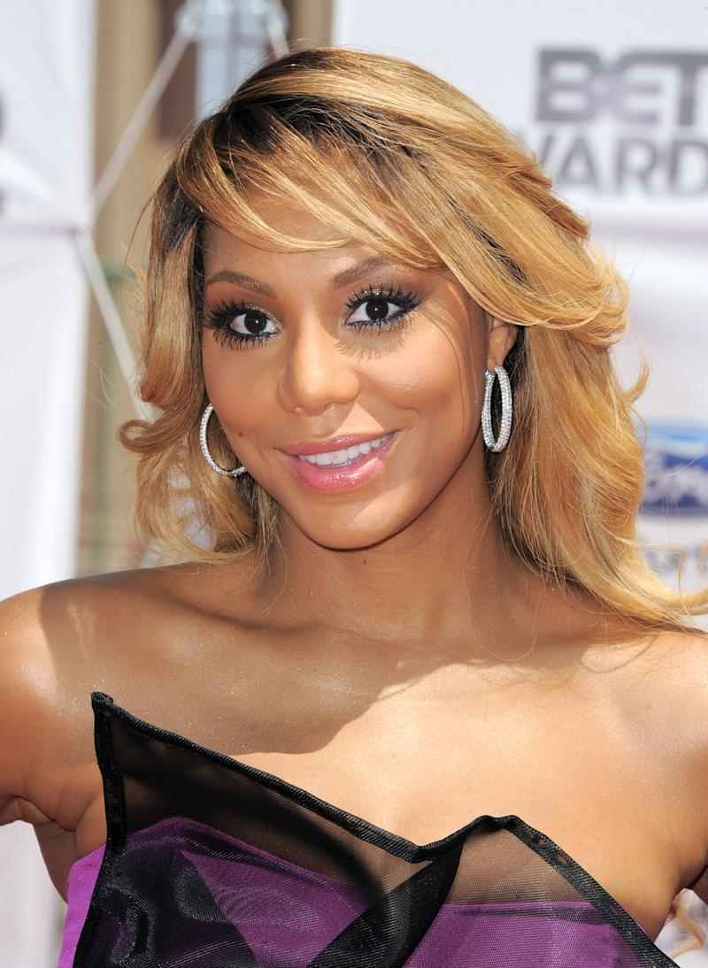 """FILE - This July 1, 2012 file photo shows Tamar Braxton at the BET Awards in Los Angeles. Braxton is nominated for three honors at Sunday's Grammy Awards, including best urban contemporary album for her first album in 13 years, """"Love and War."""" The title track is also nominated for best R&B song and R&B performance. (Photo by Jordan Strauss/Invision/AP, File)"""