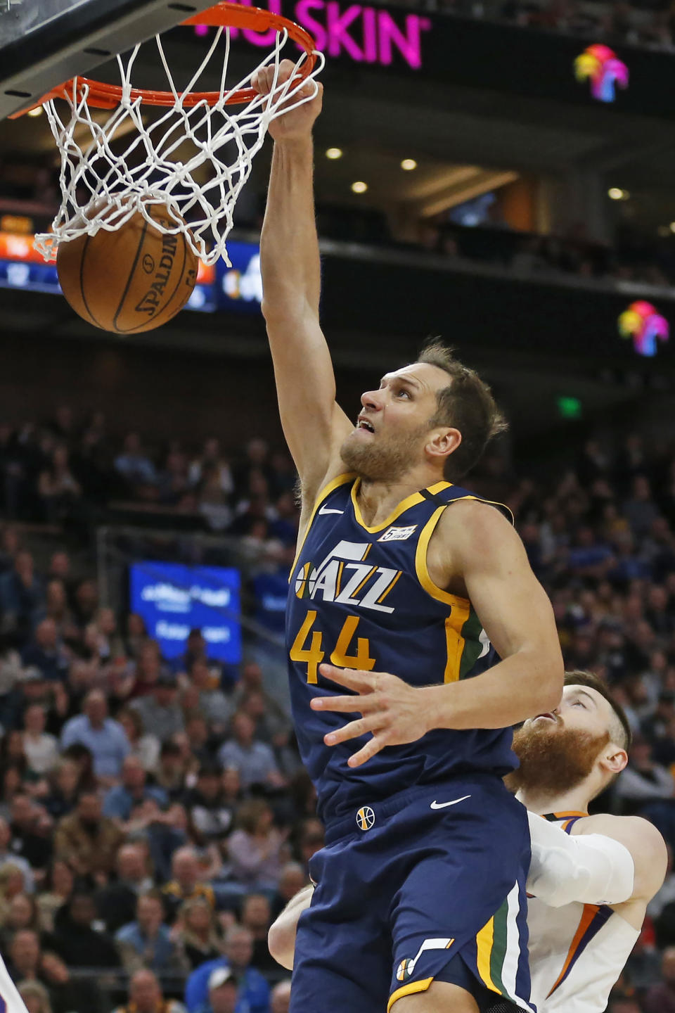 Utah Jazz forward Bojan Bogdanovic (44) dunks against Phoenix Suns center Aron Baynes, bottom right, in the first half during an NBA basketball game Monday, Feb. 24, 2020, in Salt Lake City. (AP Photo/Rick Bowmer)