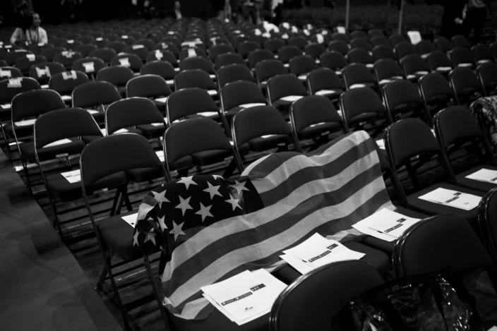 <p>A flag is used to reserve seats. (Photo: Khue Bui for Yahoo News)</p>
