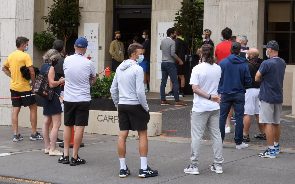 Tennis players queue for a Covid-19 coronavirus test at a hotel in Melbourne on February 4, 2021.