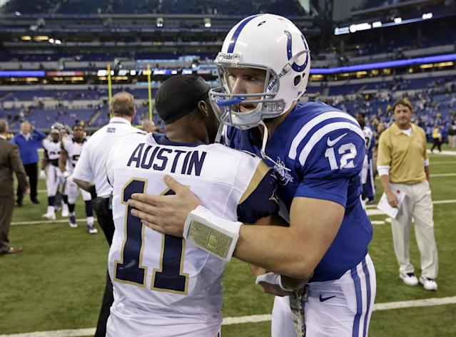 Indianapolis Colts quarterback Andrew Luck, right, greets St. Louis Rams wide receiver Tavon Austin following an NFL football game in Indianapolis, Sunday, Nov. 10, 2013. The Rams defeated the Colts 38-8. (AP Photo/AJ Mast)
