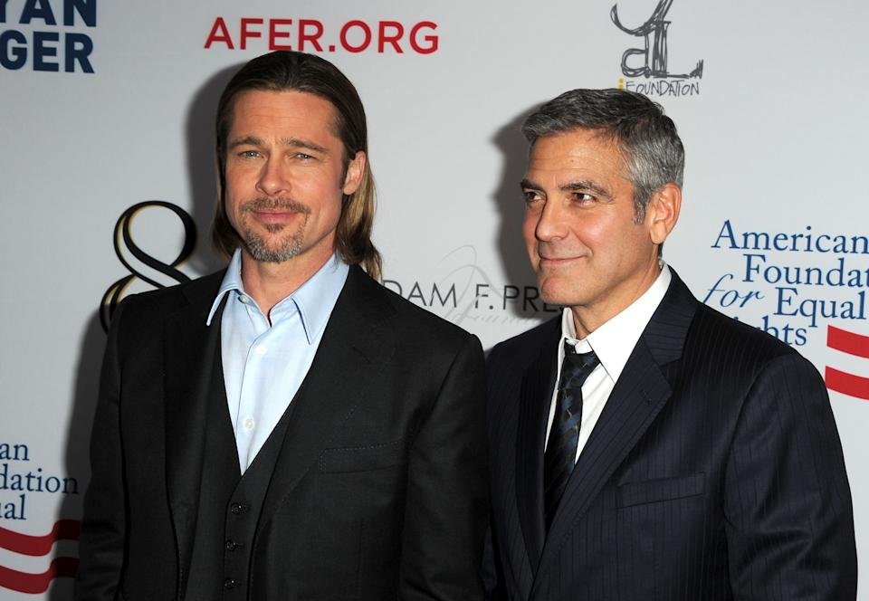 Brad Pitt and George Clooney arrive at the premiere of '8' presented by The American Foundation For Equal Rights & Broadway Impact on March 3, 2012. (Photo by Kevin Winter/Getty Images)