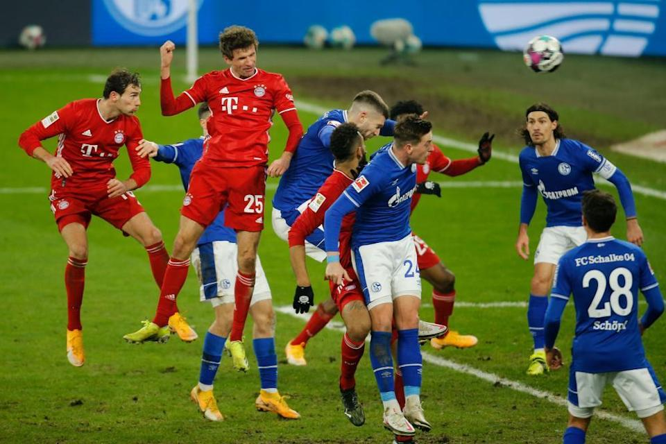 Thomas Müller rises to score for Bayern Munich in a 4-0 win over Schalke in January that followed September's 8-0 victory against them.