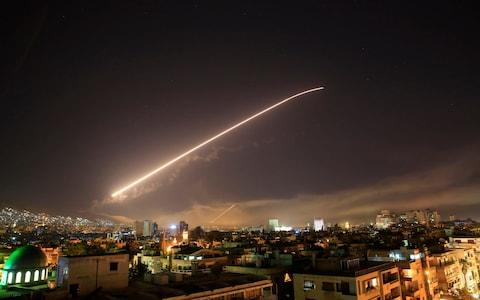 Damascus sky lights up with service to air missile fire as the U.S. launches an attack on Syria targeting different parts of the Syrian capital Damascus, Syria, early Saturday, April 14, 2018 - Credit: AP
