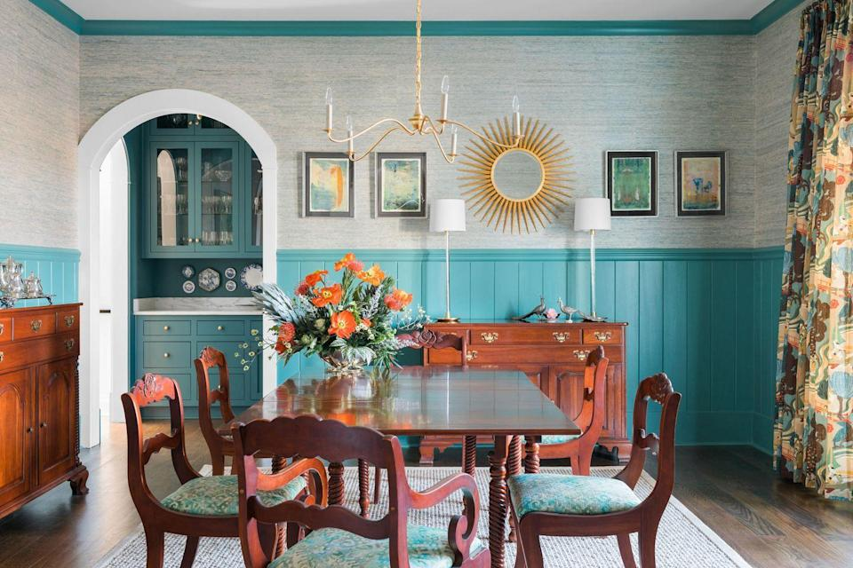 """<p>Here, design firm Cloth & Kind utilized Phillip Jefferies Arrowroot Revival in Soft Malachite, which the team says was a """"shoo-in for creating a sublime and textural backdrop"""" with Benjamin Moore's Waterbury Green on the V-groove wainscot, which pairs swimmingly with their client's antique mahogony furnishings. </p>"""